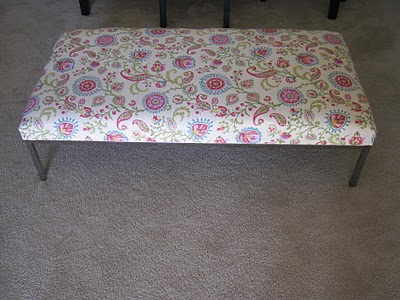 Fancy Ikea hacked coffee table turned upholstered ottoman