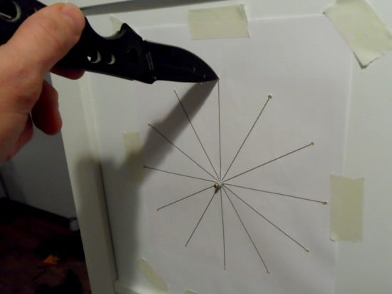 Use spike (or knife) to mark places for clock numbers