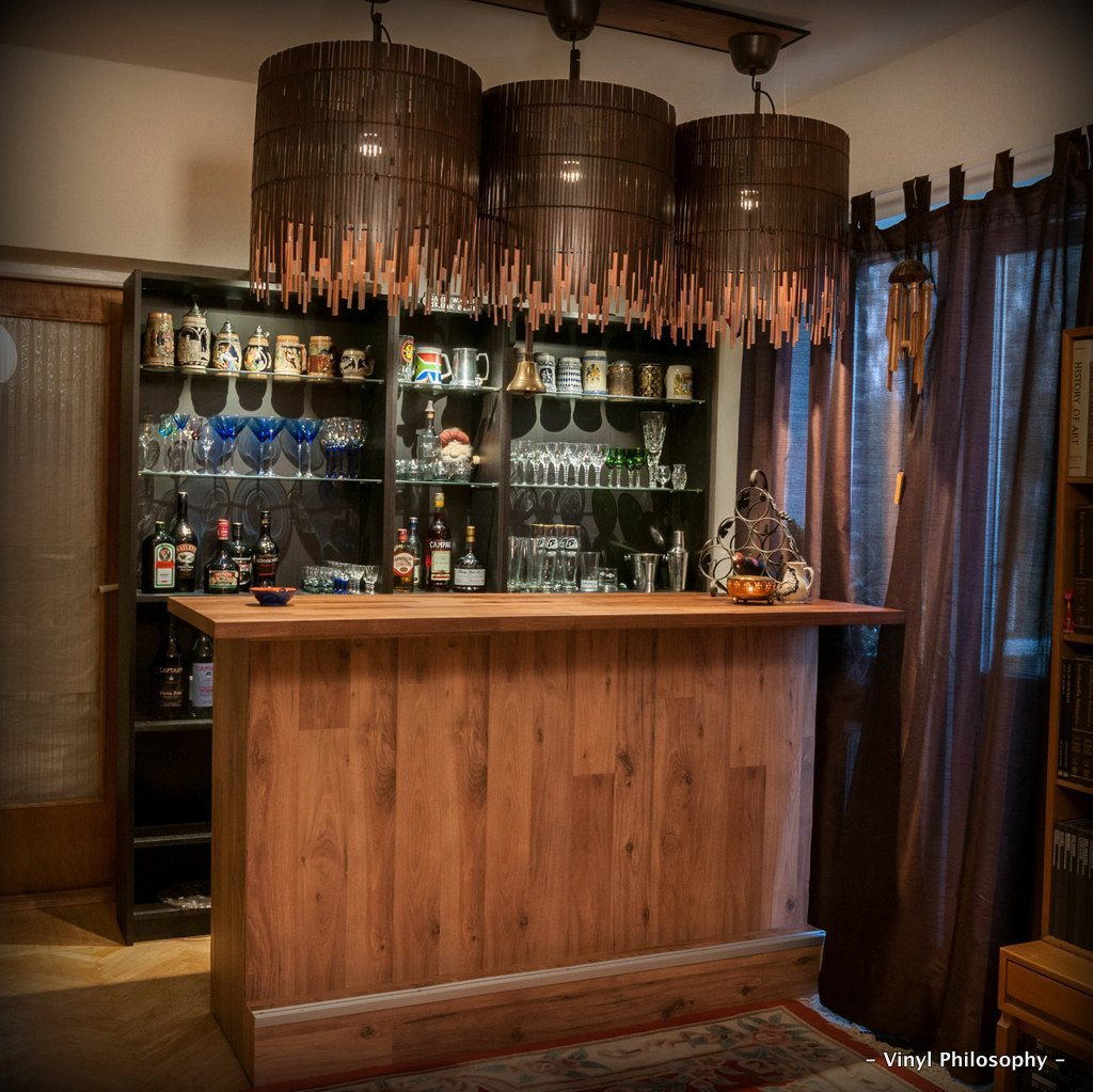 Diy home bar built from billy bookcases ikea hackers for How to build a wall bar