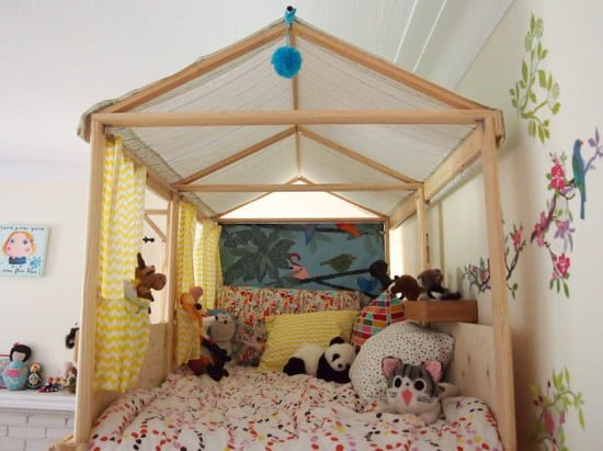 Loft bed, under a fabric roof