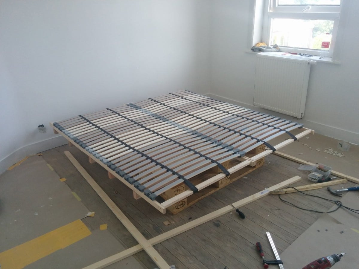 L nset pallet bed ikea hackers ikea hackers for How to make a pallet bed with drawers