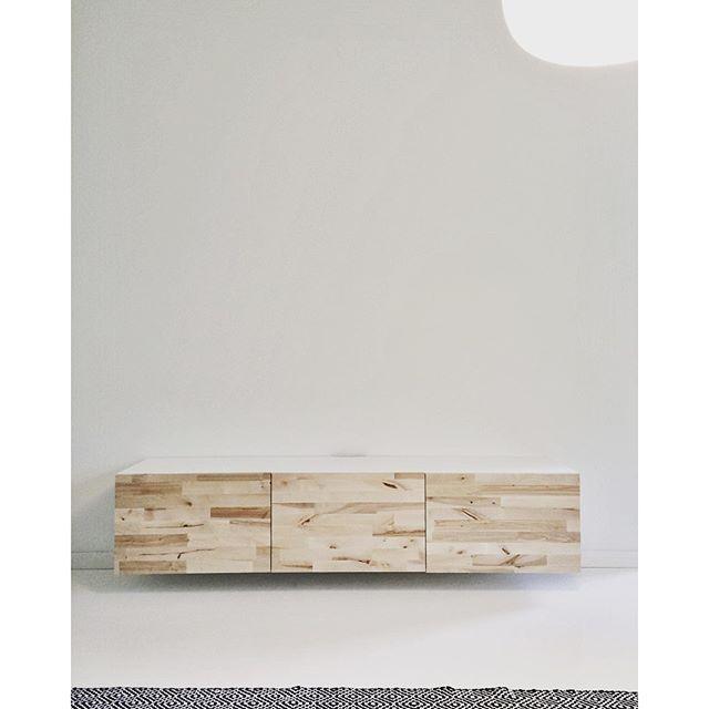 A wall-mounted IKEA Bestå TV stand