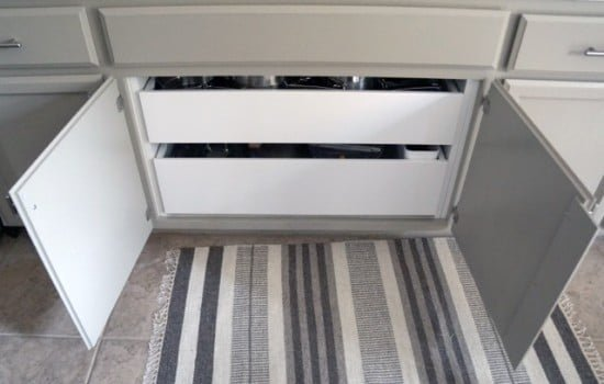 Install drawer pullouts under cooktop