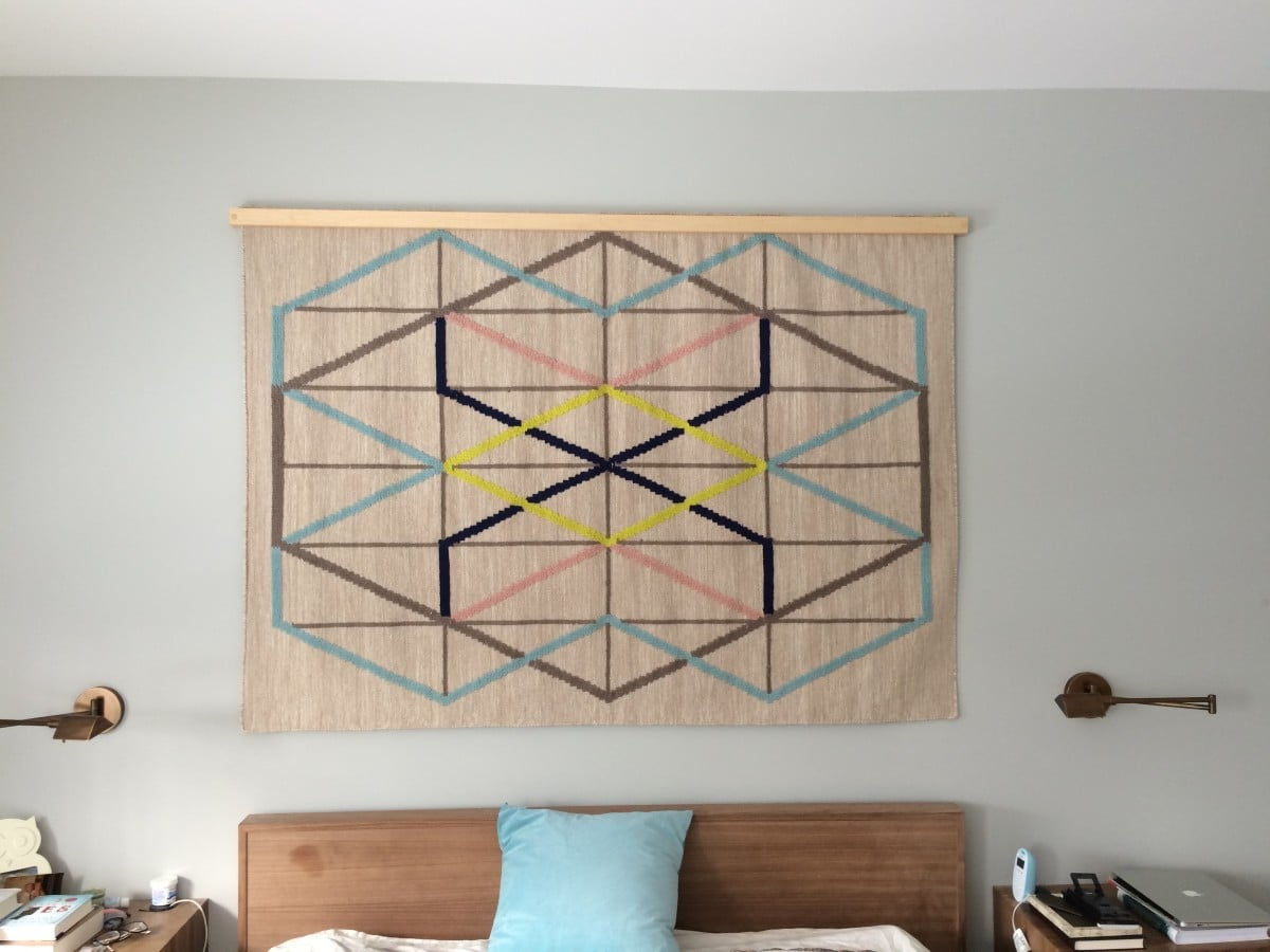 Creating A Wood Quilt Hanger Turns An Ikea Rug Into A Wall Tapestry