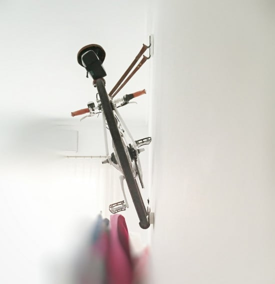 Put the bike pedal that is against the wall at its upmost position.