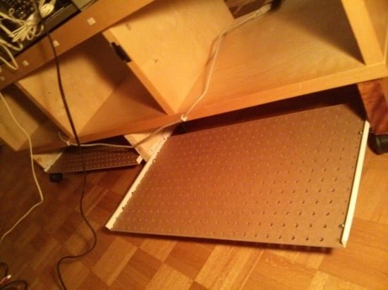 A pegboard cable management tray to keep cords off the floor