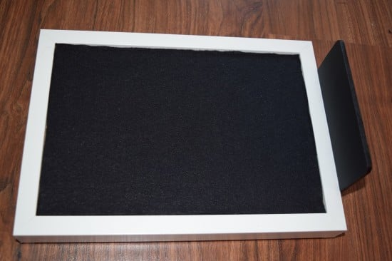 Glue the wooden backdrop to the frame and glue black fabric on it.