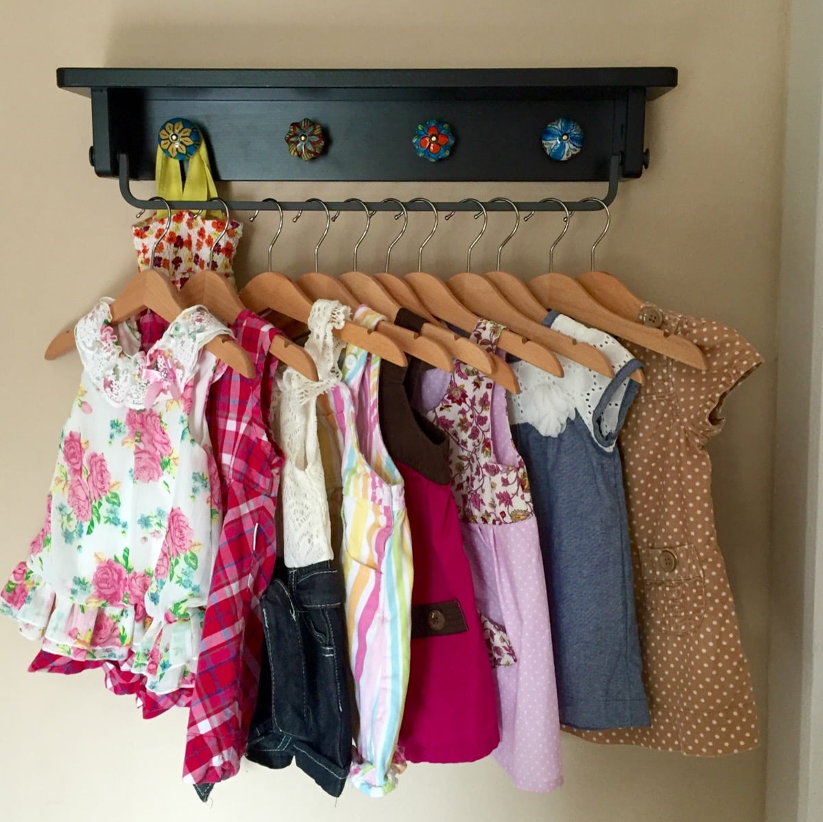 Playful space saving baby clothing rack wall hung ikea for Hanger for clothes ikea