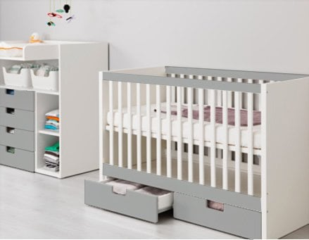 STUVA cot with HIMMELSK bumper pad as crib skirt