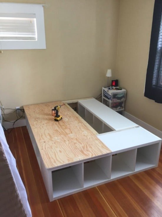 Queen platform bed made from Ikea Kallax shelves on Hello Lovely