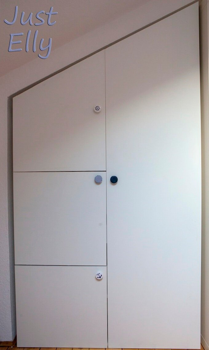 Angled wardrobe door for closet or sewing cabinet