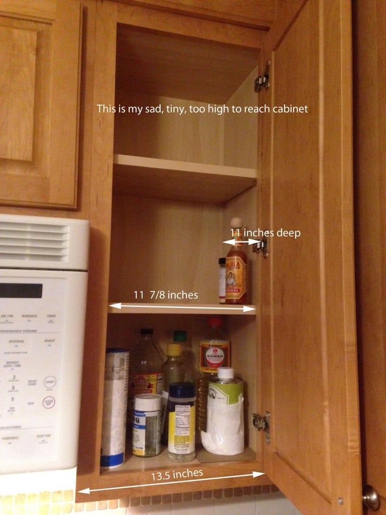 We bought and tried the rubbermaid pull down spice rack which fits standard sized cabinets but it was just too big for our cabinet