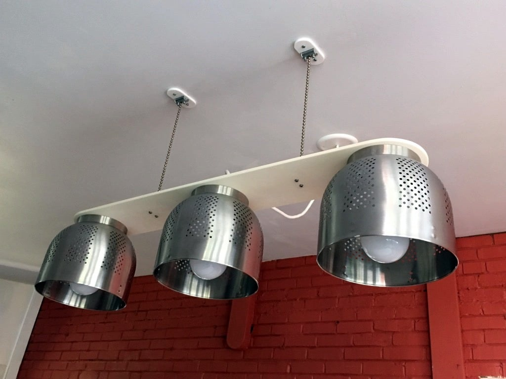 A Colander Chandelier, a modern dining table light