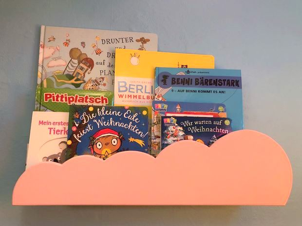 A kid's bookshelf with customised front