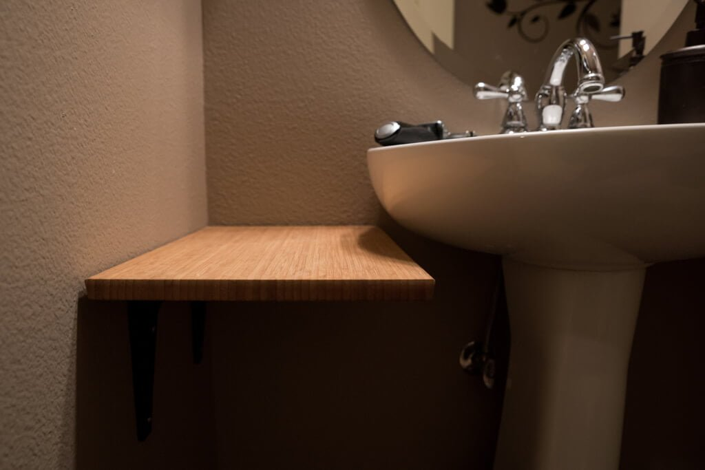 Add counter space to small bathroom with this hack