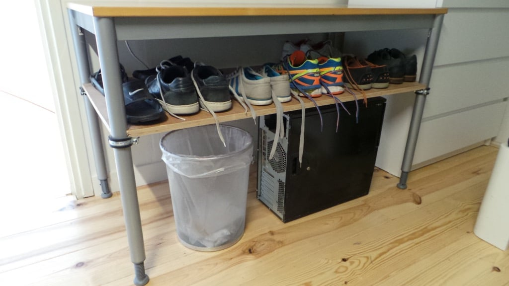 Converting an unused desk into a shoe rack