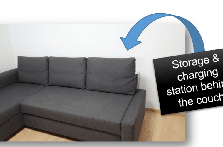 Behind the couch storage and charge station