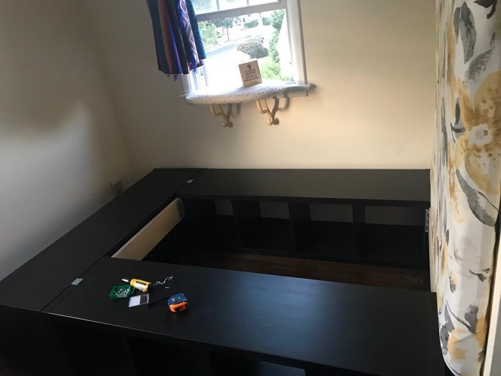 A full-sized bed built from KALLAX shelves + a DIY headboard