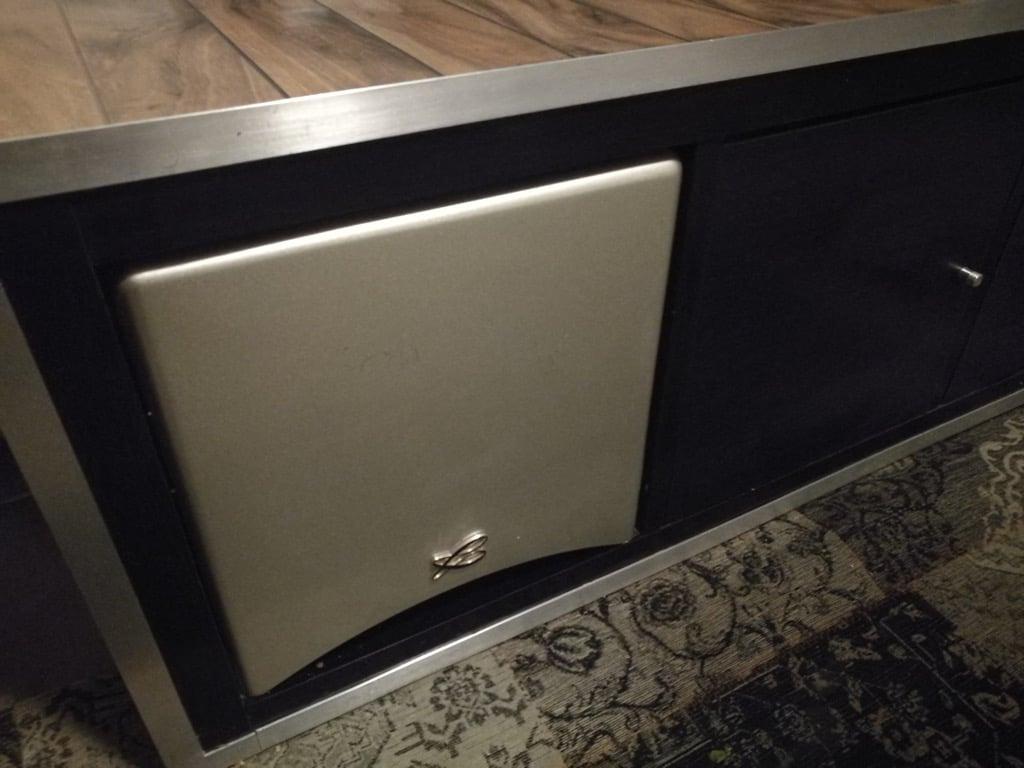 A discreet subwoofer cabinet in a KALLAX unit
