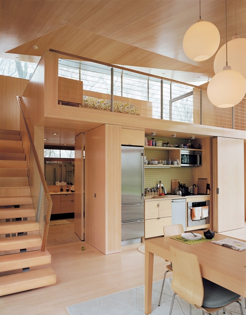 hidden kitchen behind sliding doors