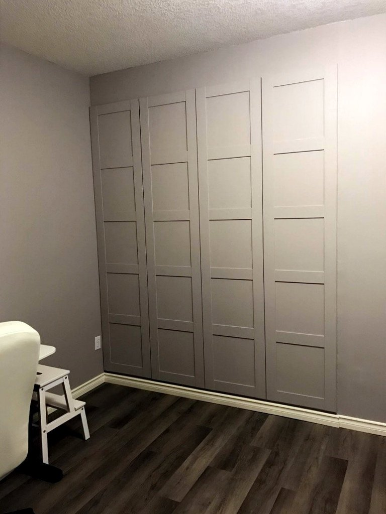 PAX wardrobe built into the wall of alcove with angled wall