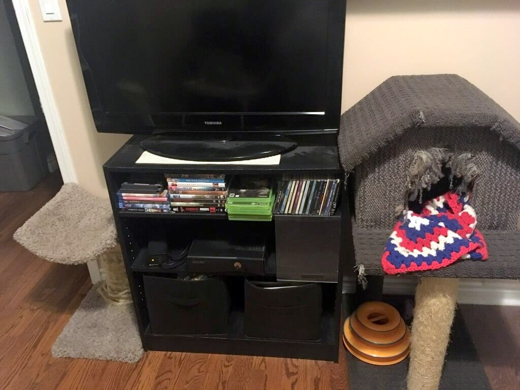 tiny home makeover - before - tv stand