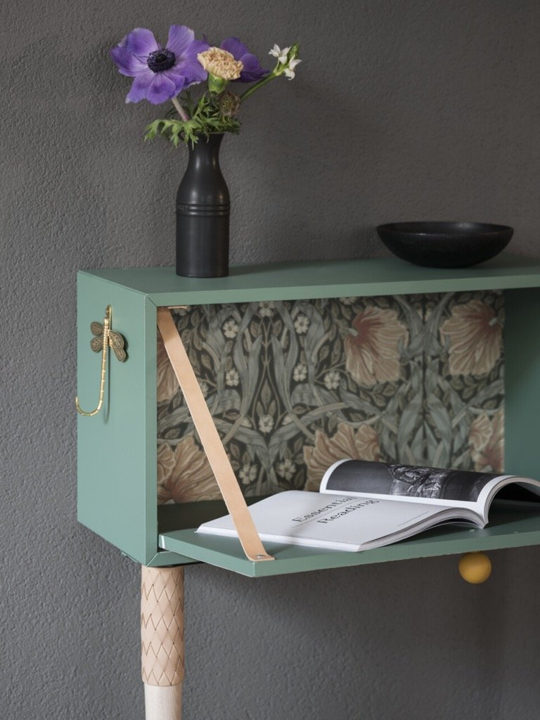 nightstand with vintage wallpaper