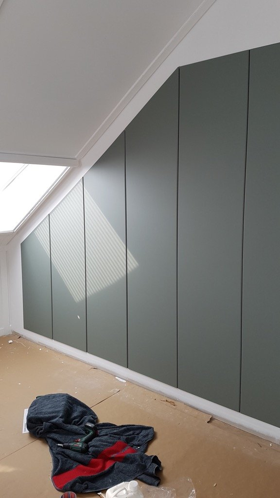 cut closet door under sloped ceiling