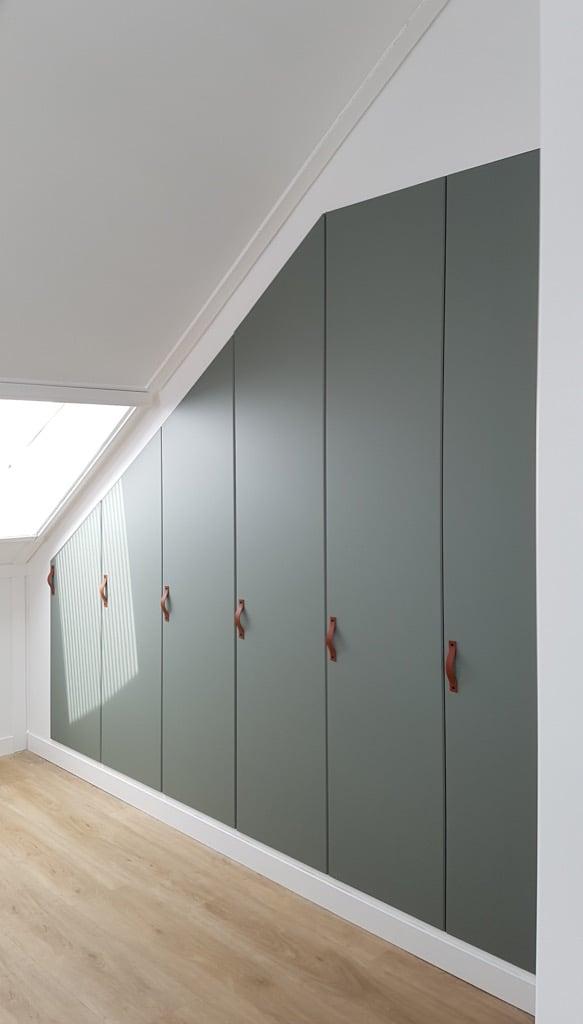 PAX built in closet REINSVOLL doors under sloped ceiling