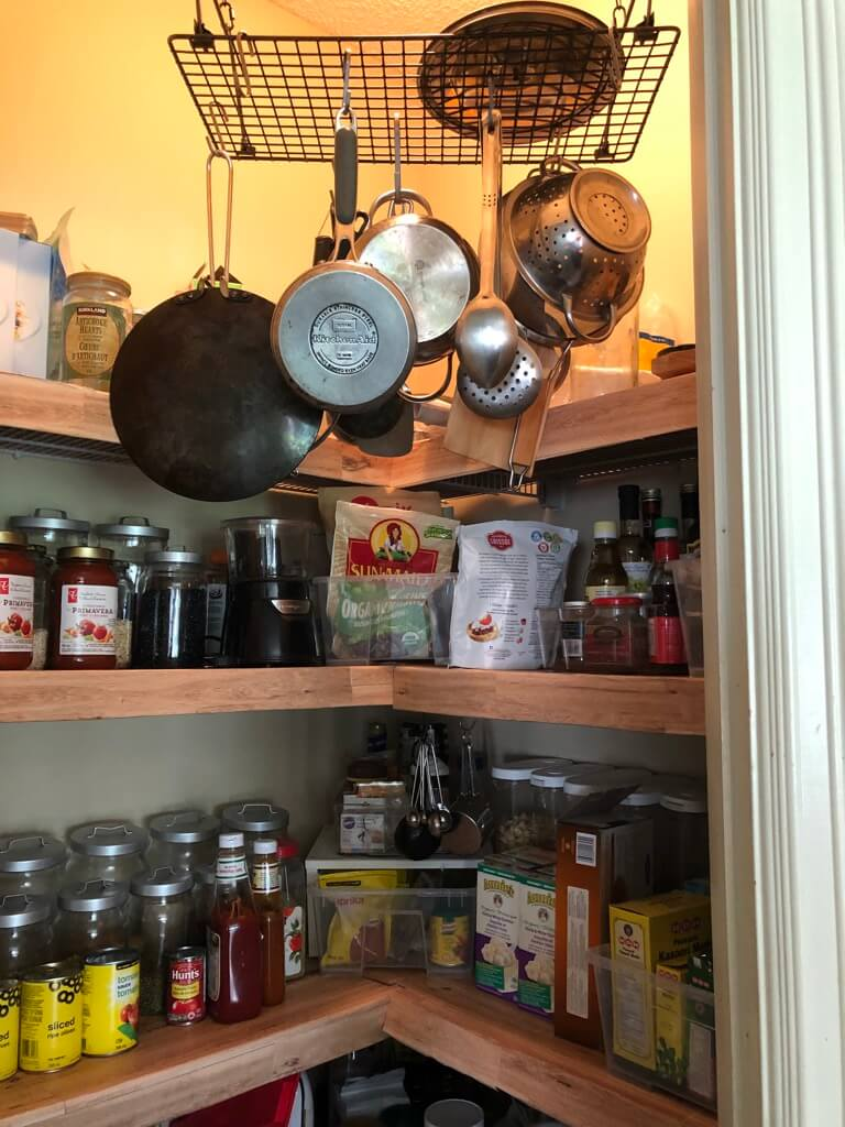 hanging pot rack in corner pantry