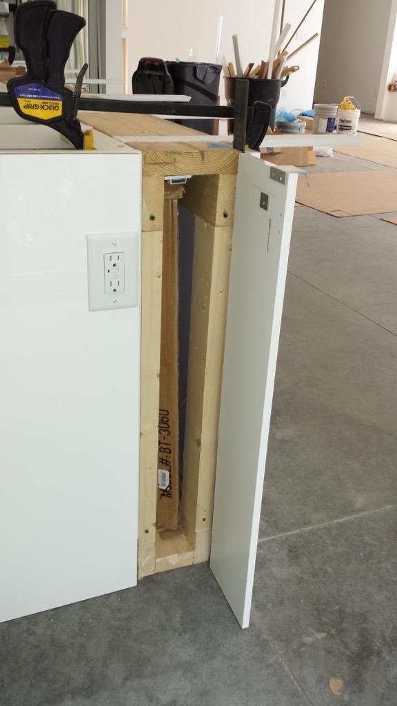 hidden storage compartment in kitchen island
