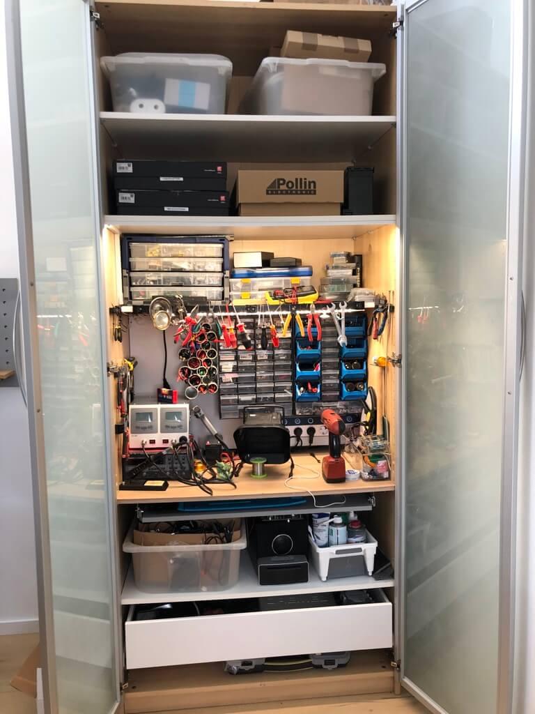 electronics workbench in an IKEA PAX closet
