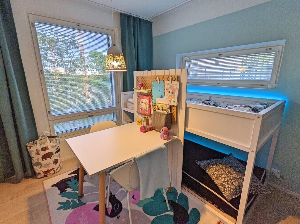 girl's room with bunk bed and large desk