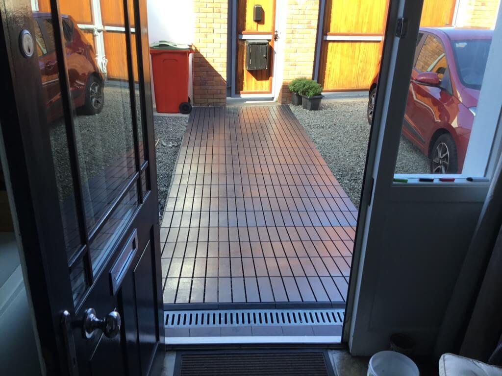 screwed down on pavement - runnen floor decking tiles