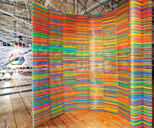 2000 Recycled IKEA Hangers Become A Room Divider