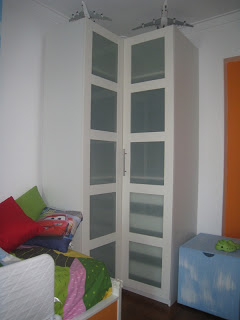 Ikea corner closet modified to fit beam
