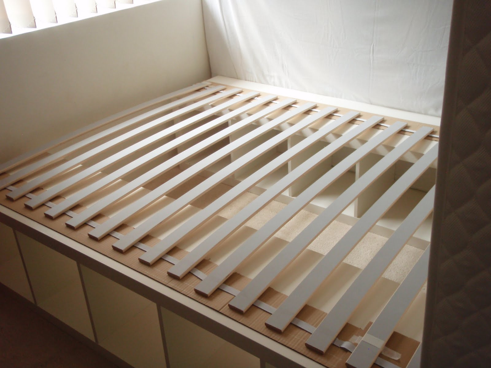 also the bed slats are held together with fabric strip to keep them evenly spaced this image shows it clearly though the bedframe here is