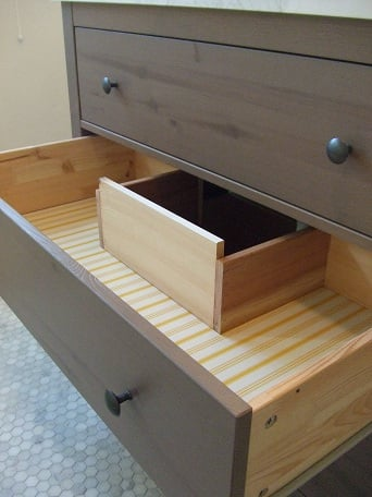 Reconfigure the top two drawers as shown in the pictures we used