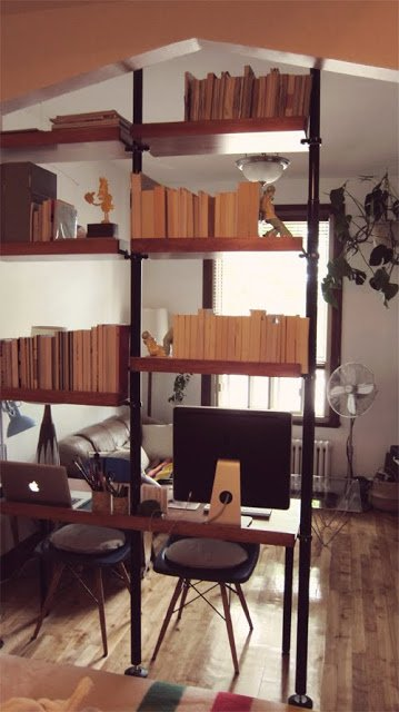 mid century modern room partition with shelving and desk