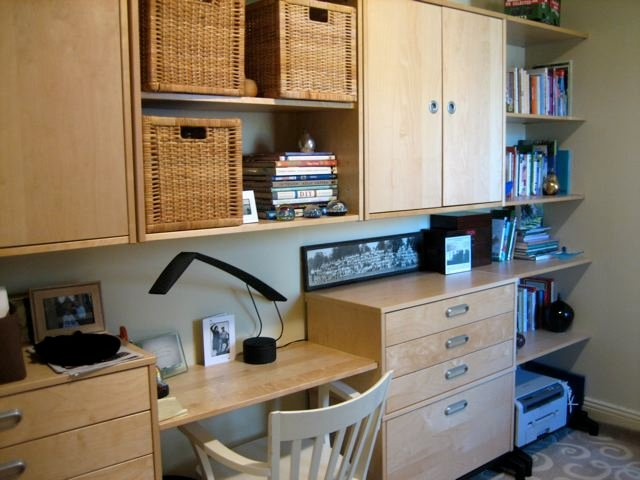 The sides of the original cabinet became the lower bookcase shelves. The  interior shelf became the top shelf and